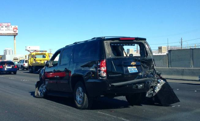 A Chevrolet Suburban sits wrecked on Interstate 15 north of Sahara Avenue on Friday, Oct. 26, 2012. The SUV was one of five vehicles in an accident involving U.S. Sen. Harry Reid's motorcade. It was not clear whether this was the vehicle carrying Reid.