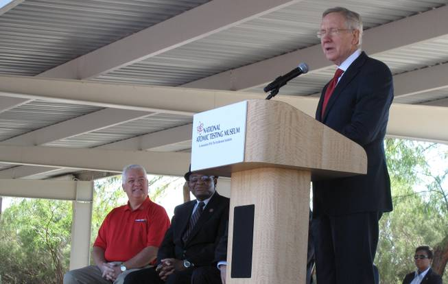 U.S. Sen. Harry Reid, right, speaks at the dedication ceremony of the National Atomic Testing Museum on Friday, Oct. 26. Watching on are Kevin Fitzgerald of the Cold War Patriots, left, and Bishop Sylvester Hooks.