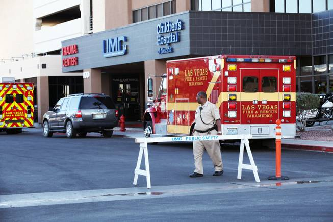 A hospital security officer patrols outside the Trauma Center at University Medical Center Friday, Oct. 26, 2012; the admittance area outside the Trauma Center was barricaded while Sen. Harry Reid was being treated at the hospital.