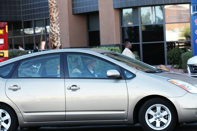 Rory Reid drives away from UMC hospital where father Sen. Harry Reid was being treated following a five car accident on I-15 near Sahara Ave on Friday, Oct. 26, 2012.