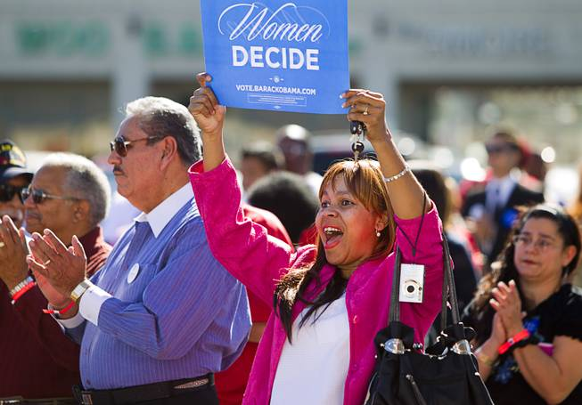 Elizabeth Rufus holds up a sign during an Asian American and Pacific Islander early voting rally for President Obama at the Chinatown Mall on Saturday, Oct. 27, 2012.