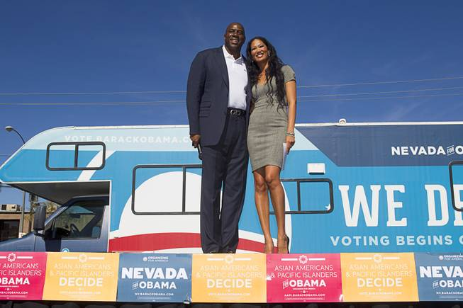 "Basketball legend Earvin ""Magic"" Johnson and fashion designer and reality TV star Kimora Lee Simmons campaign for President Obama during an Asian American and Pacific Islander at the Chinatown Mall on Saturday, Oct. 27, 2012."