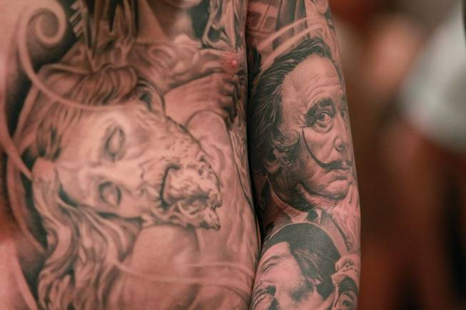 A man displays his tattoos, including Salvador Dali, at Mario Barth's Biggest Tattoo Show On Earth at the Mirage Saturday, Oct. 27, 2012.