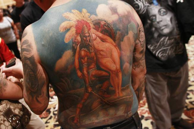 A man displays his back tattoo depicting an Aztec legend similar to Romeo and Juliet at Mario Barth's Biggest Tattoo Show On Earth at the Mirage Saturday, Oct. 27, 2012.
