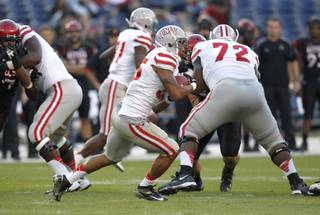 UNLV's Tim Cornett carries on a 64-yard touchdown run against UNLV during an NCAA college football game Saturday, Oct. 27, 2012, in San Diego.