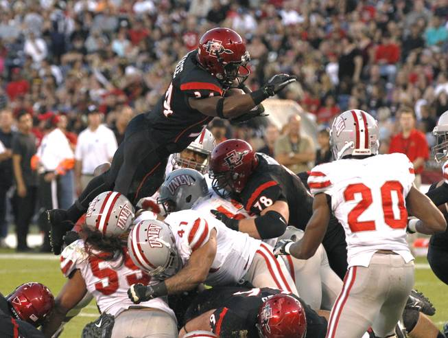 San Diego State's Walter Kazee goes over the top for a 1-yard touchdown against UNLV during an NCAA college football game Saturday, Oct. 27, 2012, in San Diego.