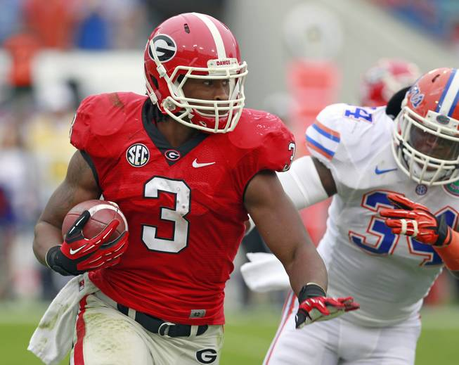 Georgia running back Todd Gurley gets around Florida linebacker Lerentee McCray for yardage during the first half Saturday, Oct. 27, 2012, in Jacksonville, Fla.