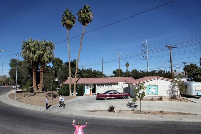 The tour bus stops at a home in the Paradise Palms neighborhood during a midcentury modern bus tour of homes in Las Vegas on Sunday, October 28, 2012.