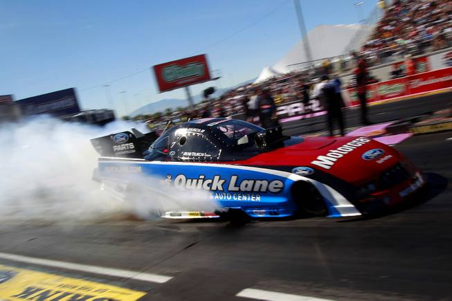 Bob Tasca III smokes his tires during the 12th Annual Big O Tires Nationals NHRA drag race on The Strip at Las Vegas Motor Speedway Sunday, Oct. 28, 2012.