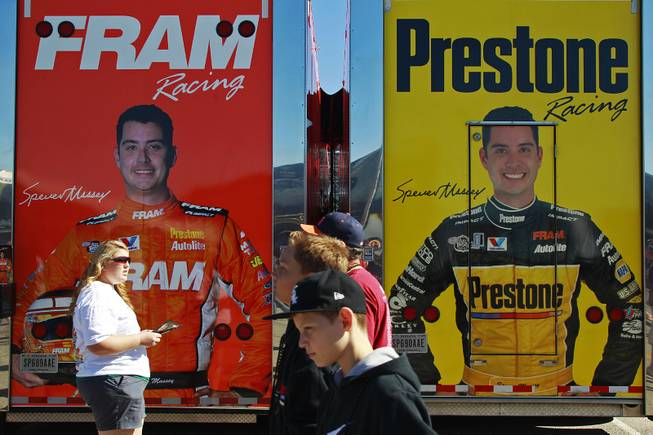 Fans walk by top fuel driver Spencer Massey's trailers during the 12th Annual Big O Tires Nationals NHRA drag race on The Strip at Las Vegas Motor Speedway Sunday, Oct. 28, 2012.