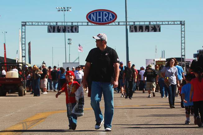 Race fans walk down Nitro Alley during the 12th Annual Big O Tires Nationals NHRA drag race on The Strip at Las Vegas Motor SpeedwaySunday, Oct. 28, 2012.