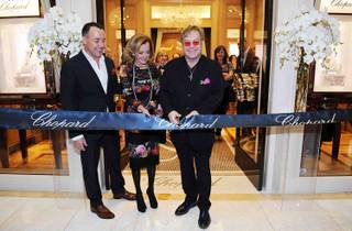 David Furnish, Caroline Scheufele and Sir Elton John at the grand opening of Chopard in Wynn Las Vegas on Sunday, Oct. 28, 2012.
