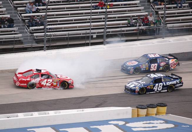 Juan Pablo Montoya (42) spins in front of Jimmie Johnson (48) and Travis Kvapil (93) during the NASCAR Sprint Cup Series auto race at Martinsville Speedway, Sunday, Oct. 28, 2012, in Martinsville, Va.