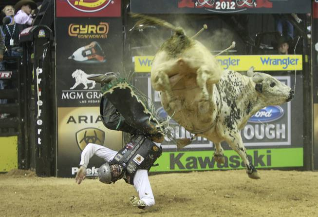 Jordan Hupp of Cheyenne, Wyo. gets thrown from a bull during the Built Ford Tough Series Professional Bull Riders (PBR) World Finals at the Thomas & Mack Center Sunday, Oct. 28, 2012.