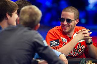 Greg Merson, right, talks with players during the World Series of Poker Main Event final table at the Rio on Monday, Oct. 29, 2012.