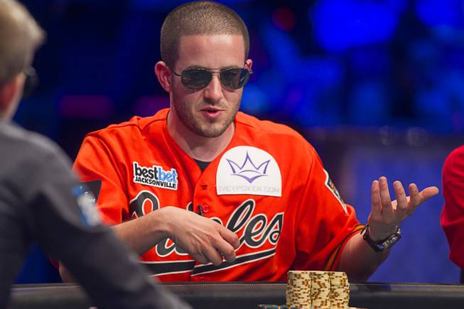 Greg Merson, right, stacks chips during the World Series of Poker Main Event final table at the Rio on Monday, Oct. 29, 2012.
