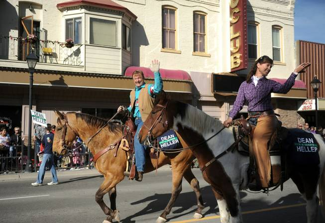 Senator Dean Heller and his wife Lynn, ride horses during the Nevada Day Parade Saturday, Oct. 27, 2012 in Carson City.