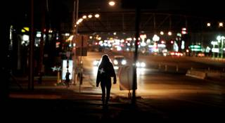 Boulder Highway is an area identified by Metro as a hotspot for prostitution and is frequently patrolled by officers. A woman is seen walking north on Boulder Highway north of Lamb Blvd. on Tuesday, October 30, 2012.
