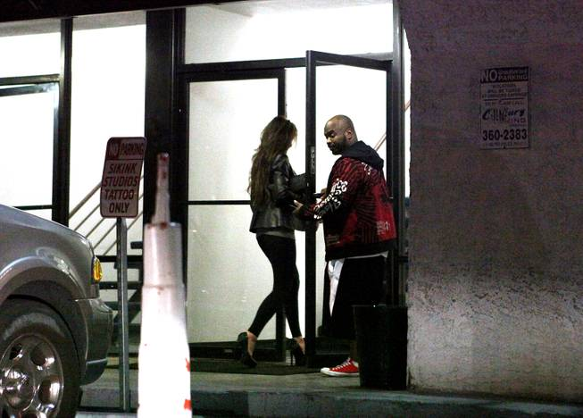 A woman walks into an escort call center identified by Metro on Tuesday, Oct. 30, 2012.