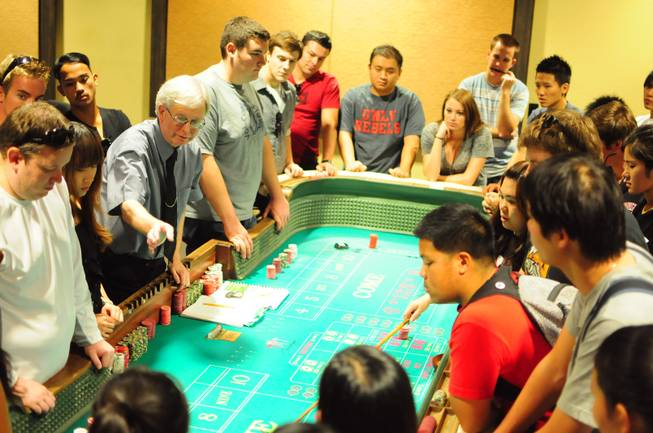 UNLV gaming professor Gary Waters explains the table game of craps to hotel college students at the Konami Gaming Lab on Tuesday, Oct. 30, 2012. The gaming lab gives students hands-on experience in casino management.