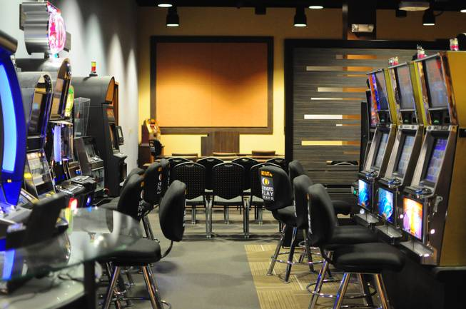 Slot machines from Konami, Bally, IGT and Aristocrat manufacturers are shown inside the Konami Gaming Lab on Tuesday, Oct. 30, 2012. The gaming lab gives students hands-on experience in casino management.