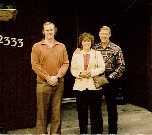 John E. Feathers, left, died in February, leaving behind a vast collection of maps in his home. His stepmother, Joyce Feathers, center, and father, John Feathers, say their son was fond of travel. This picture, taken in 1983, was provided by John Feathers.