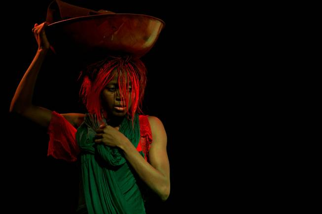 "Wassa Coulibaly performs at Baobab Stage theater during dress rehearsals for her original work ""The Red Dress"", Tuesday, Oct. 30, 2012."
