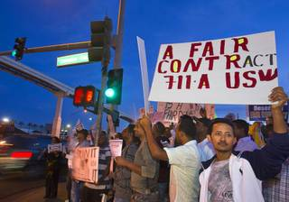 Cab drivers hold an informational picket at the intersection of Convention Center Drive and Paradise Road in front of the Las Vegas Convention Center Wednesday, October 31, 2012. The drivers' unions are in a contract dispute with Frias Transportation and disagree with proposed changes in the companys seniority policies. They also say the company does not pay drivers fair wages.