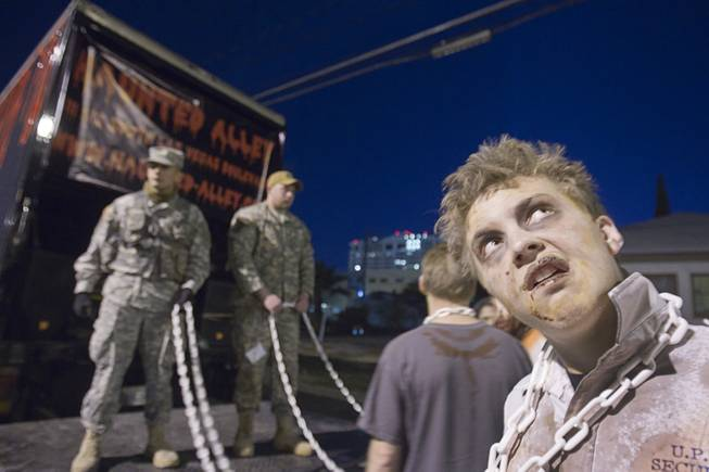 Zombie Josh Stackhouse, right, waits with a Silver State Productions Services entry during third annual Halloween Parade in downtown Las Vegas Wednesday, October 31, 2012.