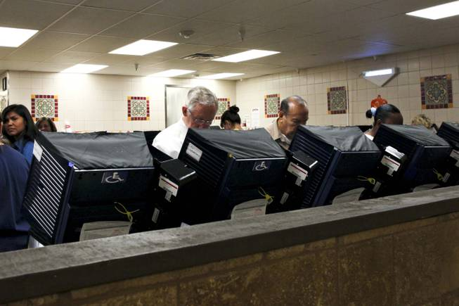 Sen. Harry Reid votes early at the Cardenas Market on East Bonanza in Las Vegas on Wednesday, Oct. 31, 2012.