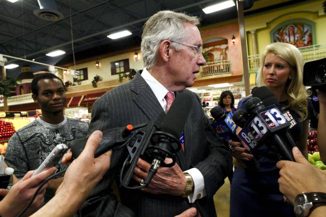 Sen. Harry Reid indicates the spot on his rib cage where he is still sore following last Fridays accident, Wednesday, Oct. 2012.