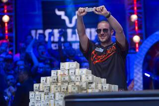Greg Merson, 24, of Laurel, Md., holds up his championship bracelet after winning the 2012 World Series of Poker Main Event at the Rio on Wednesday, Oct. 31, 2012. Merson takes home a championship bracelet and $8.5 million in prize money.