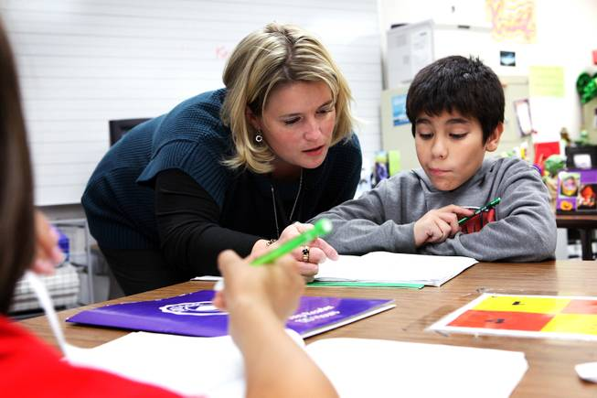 Manda Kristof, left, helps Andrew Rodriguez Quijano with an assignment while teaching a fifth grade writing class at Ferron Elementary School in Las Vegas on Wednesday, October 31, 2012.