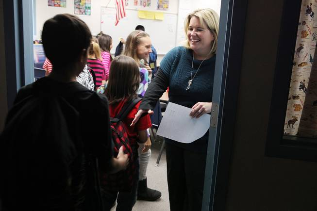 Writing teacher Manda Kristof greets fifth graders at the beginning of class at Ferron Elementary School in Las Vegas on Wednesday, October 31, 2012.