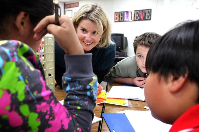 Manda Kristof helps students with assignments while teaching a fifth grade writing class at Ferron Elementary School in Las Vegas on Wednesday, October 31, 2012.