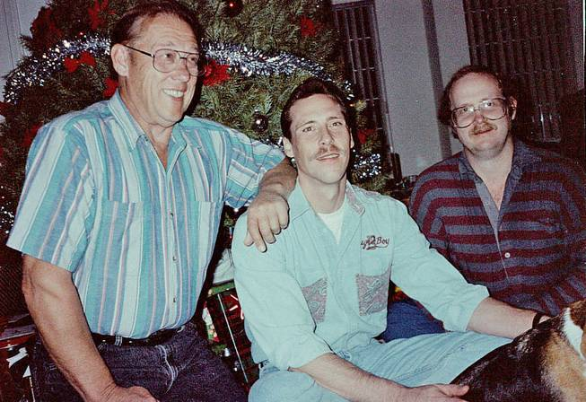 John E. Feathers, right, who died in February, left behind a vast map collection that will be donated to the Los Angeles Public Library. Here, he is shown with his father, John Feathers, left, and his brother, Bradley Feathers, in 1993.