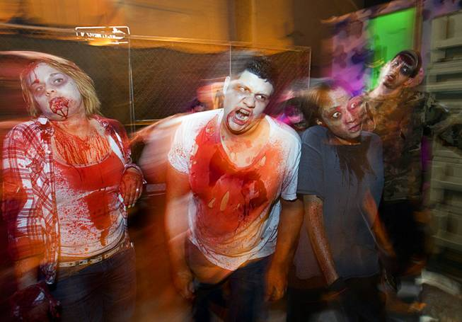 Best illustrated photo: Steve Marcus, of zombies going through a haunted alley during Halloween in downtown Las Vegas, on Wednesday, Oct. 31, 2012.