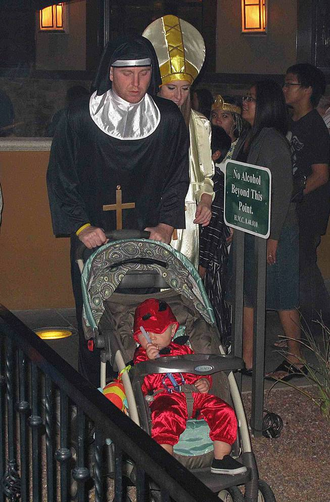 Vernon and Heidi Ferguson, dressed as a nun and the pope, push their little devil, Jean, 1, at the District's Halloween event at Green Valley Ranch in Henderson, Wednesday, Oct. 31, 2012.