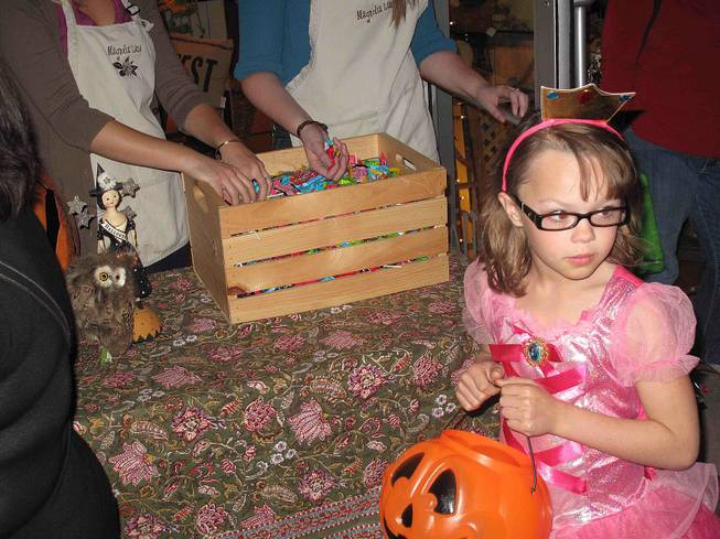 A trick-or-treating princess is shown at the District at Green Valley Ranch in Henderson, Wednesday, Oct. 31, 2012.