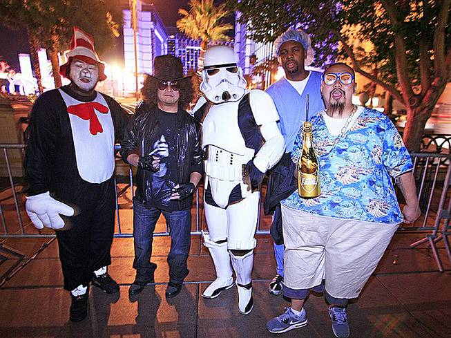 Seattle residents, from left, Chaeng Saeturn, Rodney Ofrancia, Jason Rosete, Joseph Lucas and Nai Saeteun celebrate Halloween on the Strip while in town for the SEMA convention, Oct. 31, 2012.