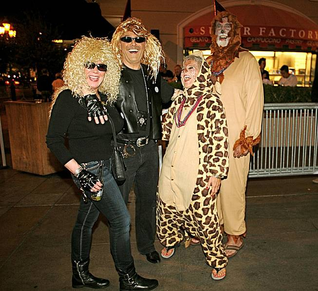 Janice Wallman, from left, Bruce Wall, Karen Libonati and Mike Libonati, of Vancouver, British Columbia,  said they've been planning their costumes for their Vegas Halloween visit since July. Oct. 31, 2012.