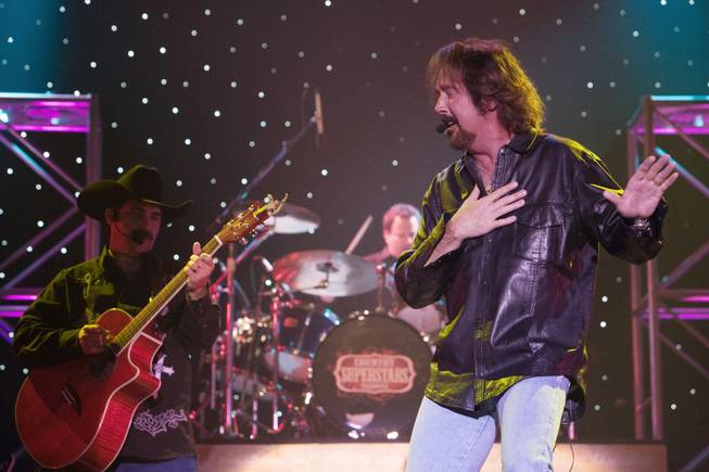 "Leonard Quenneville (left) and Ron Keel reunite Brooks and Dunn for the show they also produce, ""Country Superstars Tribute,"" at the Golden Nugget  showroom."
