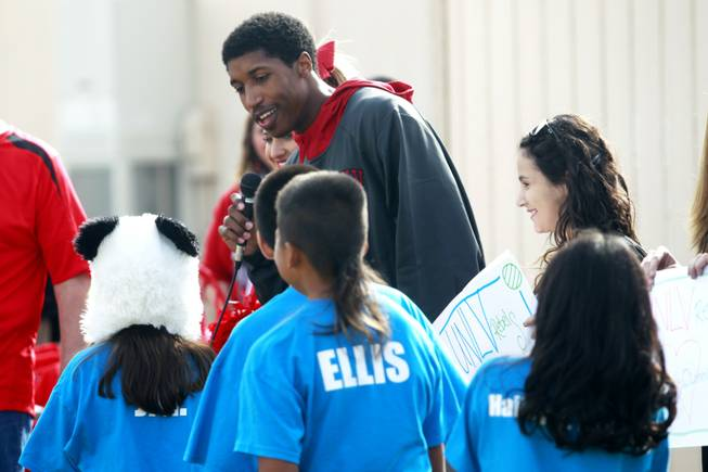 Justin Hawkins talks to students while appearing at an event at Cunningham Elementary School Nov. 1, 2012.