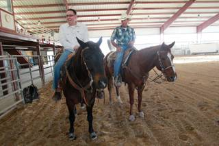 Las Vegas Sun sports editor Ray Brewer laughs while UNLV rodeo coach Ric Griffith helps him ride Anson Nov. 2, 2012.