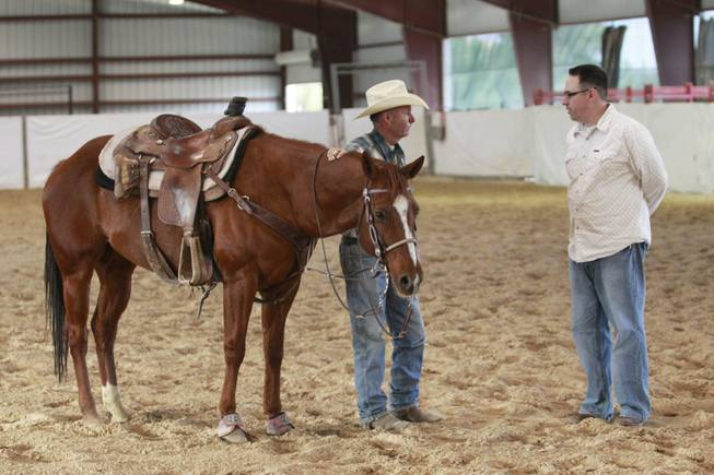 Las Vegas Sun sports editor Ray Brewer talks with UNLV rodeo coach Ric Griffith Nov. 2, 2012.