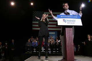 Republican vice presidential candidate, Rep. Paul Ryan, R-Wis., appears on stage with his wife Janna during a campaign event, Thursday, Nov. 1, 2012, in Reno, Nev.