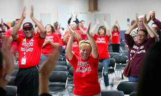 Members of Culinary 226 do a morning cheer before heading out to knock on doors as part of the union's get-out-the-vote effort, Oct. 28, 2012.