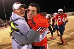 Coronado coach Brad Talich and defensive end Othman Mechkor embrace as time expires in their 24-20 win over Basic Friday, Nov. 2, 2012.