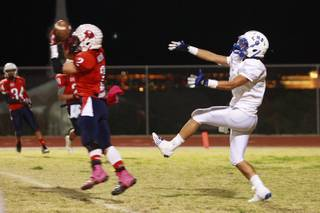 Coronado defensive back Cody Mucino intercepts a pass in the end zone intended for Basic wide receiver Anthony Owens late in the fourth quarter Friday, Nov. 2, 2012 at Coronado. Coronado shut out Basic after the first quarter for a 24-20 win. The interception killed Basic's final drive.