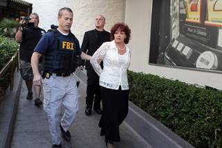 The FBI arrests Roxanne Rubin, who is charged with attempting to vote more than once in the same election, at the Riviera in Las Vegas on Friday, Nov. 2, 2012.